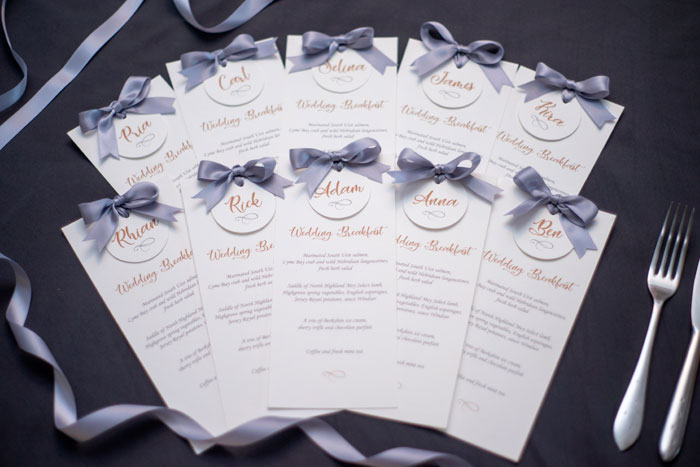 Wedding breakfast tables classic silver gold and cream menus with place name tags