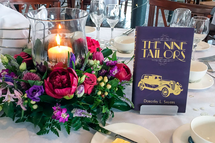 Wedding breakfast tables flat table names or numbers. Purple and gold book cover table name.