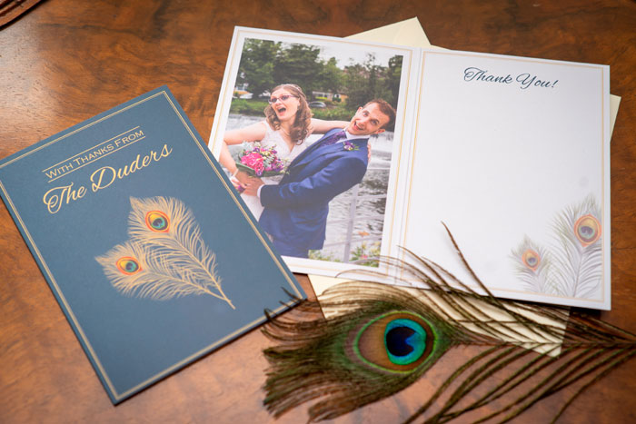 Wedding breakfast Tables blue and gold peacock themed thank you cards featuring bride and groom photo